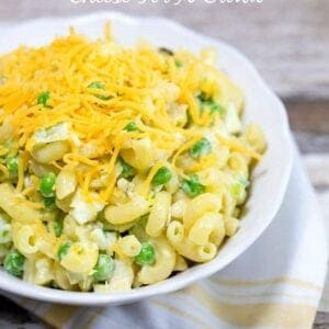 Classic Macaroni Salad With Cheese For A Crowd | This is a simple and quick recipe is easy to make, giving the noodles about 15 minutes to cook then 10 to put it together. The peas and celery give it a crisp fresh flavor that is good for you. The result is a light summery pasta salad that everyone will enjoy.