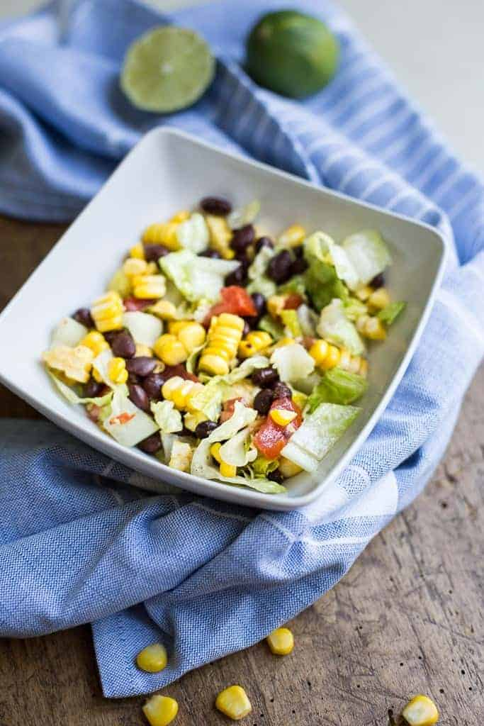 Mexican Chopped Salad is a yummy salad full of southwest flavors to help kick off the summer corn season. We made a batch of this salad thinking there would be enough left to have for lunch the next day but to my surprise there was not a kernel left. Everyone kept going back for seconds and thirds.