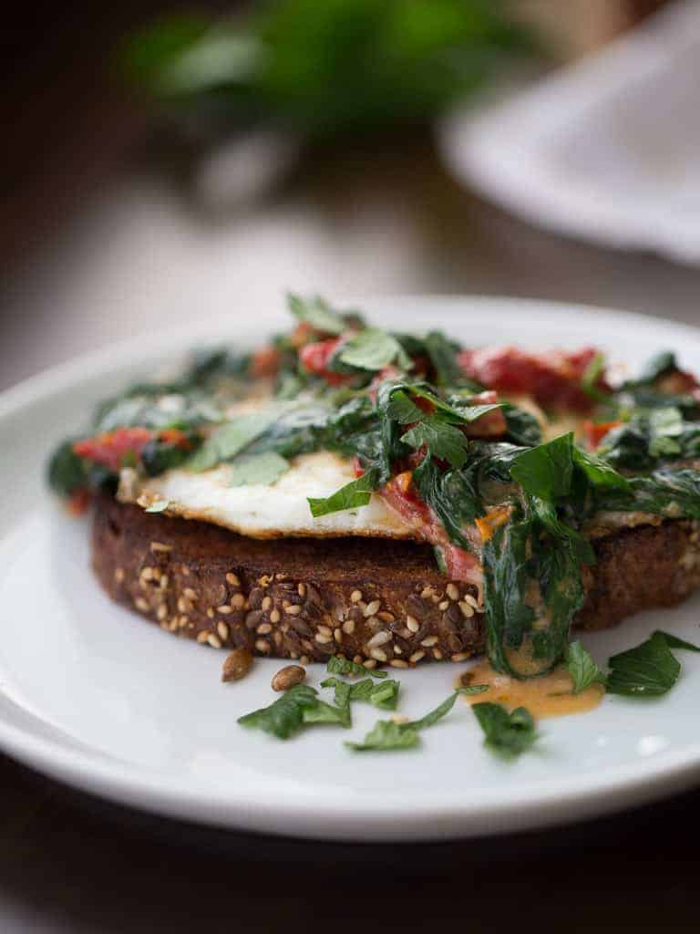 Spinach Cream Sauce With Sundried Tomatoes over Egg and Toast is a delicious and elegant breakfast or brunch to serve to your friends and family.
