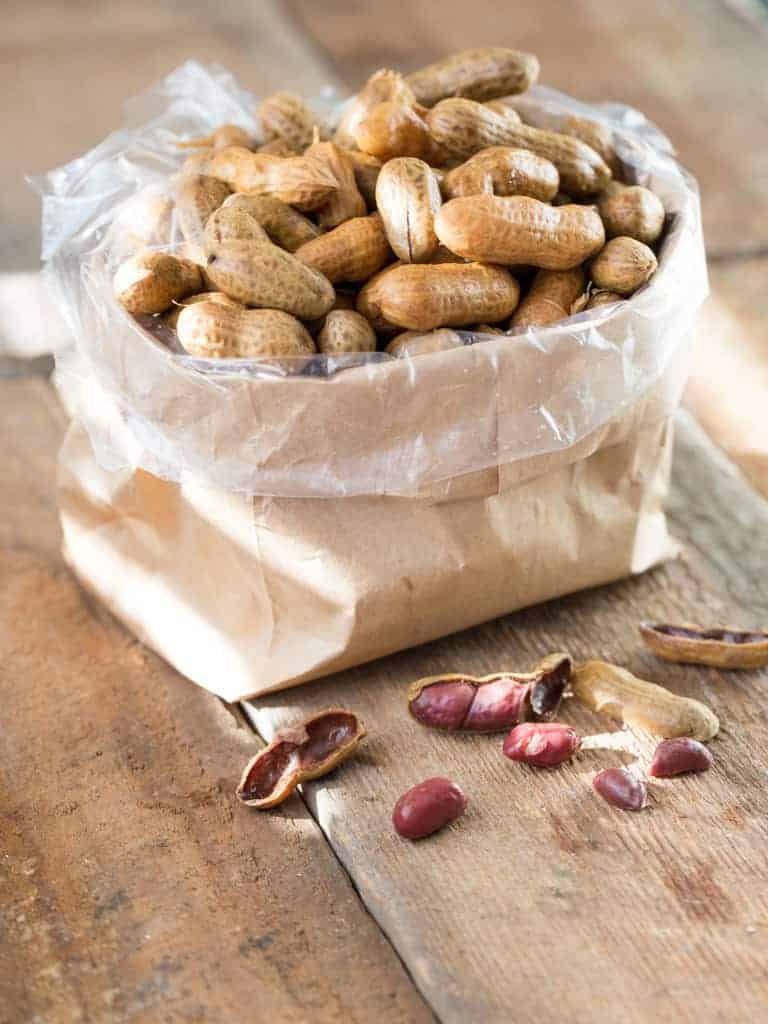 If you are from the south you know that summer brings boiled peanut stands, selling warm salty goodness in a brown paper bag. Our family likes them so much that at harvest time I canned boiled peanuts by the quart full so we could have the yummy snack all year long.