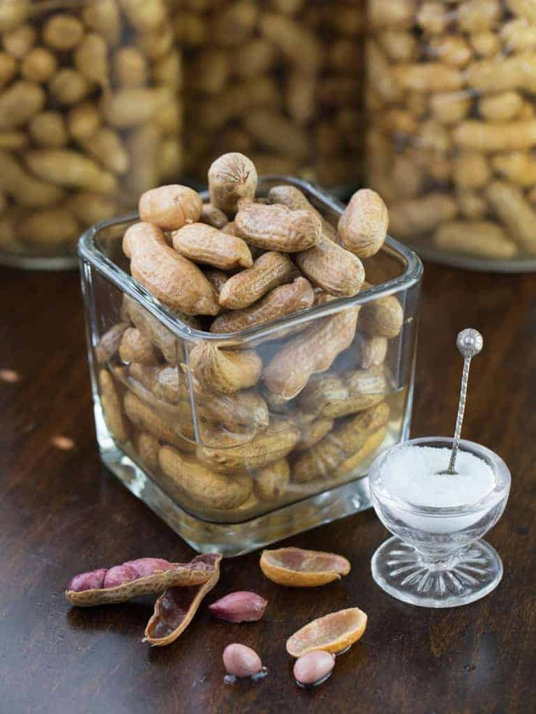 If you are from the south you know that summer brings boiled peanut stands, selling warm salty goodness in a paper bag. Our family likes them so much that at harvest time I canned boiled peanuts by the quart full so we could have the yummy snack all year long