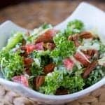 Sweet creamy dressing tossed with toasted pecans, tomatoes and crunchy cabbage create this wonderful and surprisingly Low Carb Italian Kale Salad.