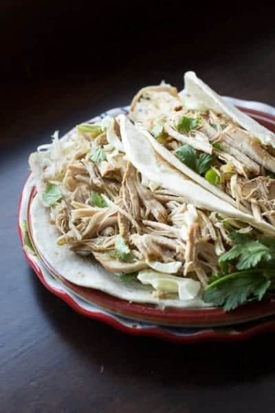Kick your tacos up to a new level of flavor with this easy to make Spicy Verde Pulled Pork recipe. You will be amazed at how easy it is to make this delicious pulled pork using the crockpot. Just put a few ingredients in the crockpot in the morning and you will have delicious mexican pork ready to be pulled for your for dinner.