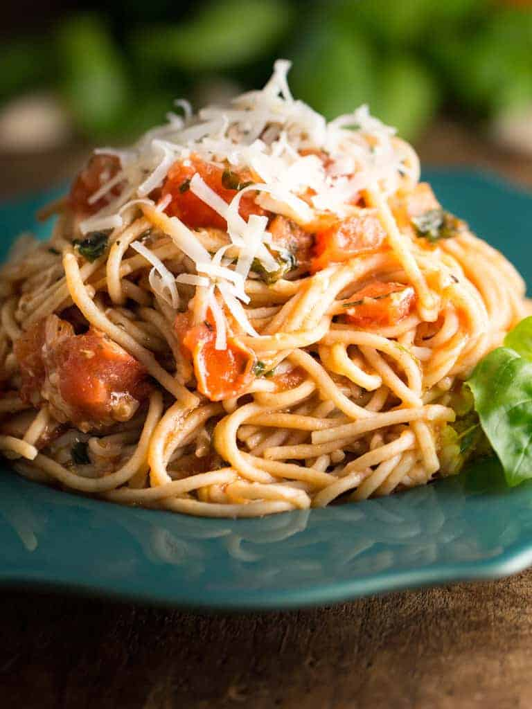 Yummy Cheesy Pasta is an easy to make dish using fresh tomatoes, basil, and garlic then generously tossing in six kinds of cheese, wrapping each bite of noodles with gooey cheesy goodness.