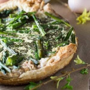 Fresh picked asparagus in a creamy filling on top a light crispy puff pastry shell