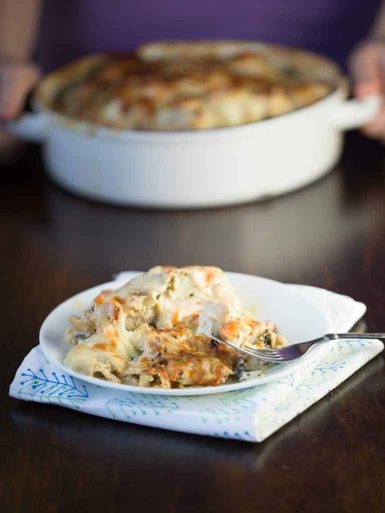 Amazing is what your family will say when you fix this Easy Italian Chicken. Creamy Italian flavored cream sauce with colorful peppers, onions and garlic envelop baked chicken that is topped with toasted mozzarella cheese to create a memorable meal you family will ask for again and again.