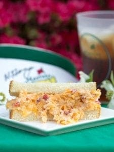 The Masters Pimento Cheese Recipe is a classic southern tradition, full of creamy swiss and cheddar cheese mixed in with just the right amount of pimentos.