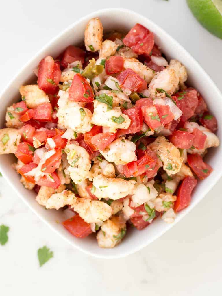 Shrimp Pico De Gallo is full of zesty lime flavor, sweet onion, cilantro and yummy spicy shrimp that packs a punch to all your Mexican dishes.
