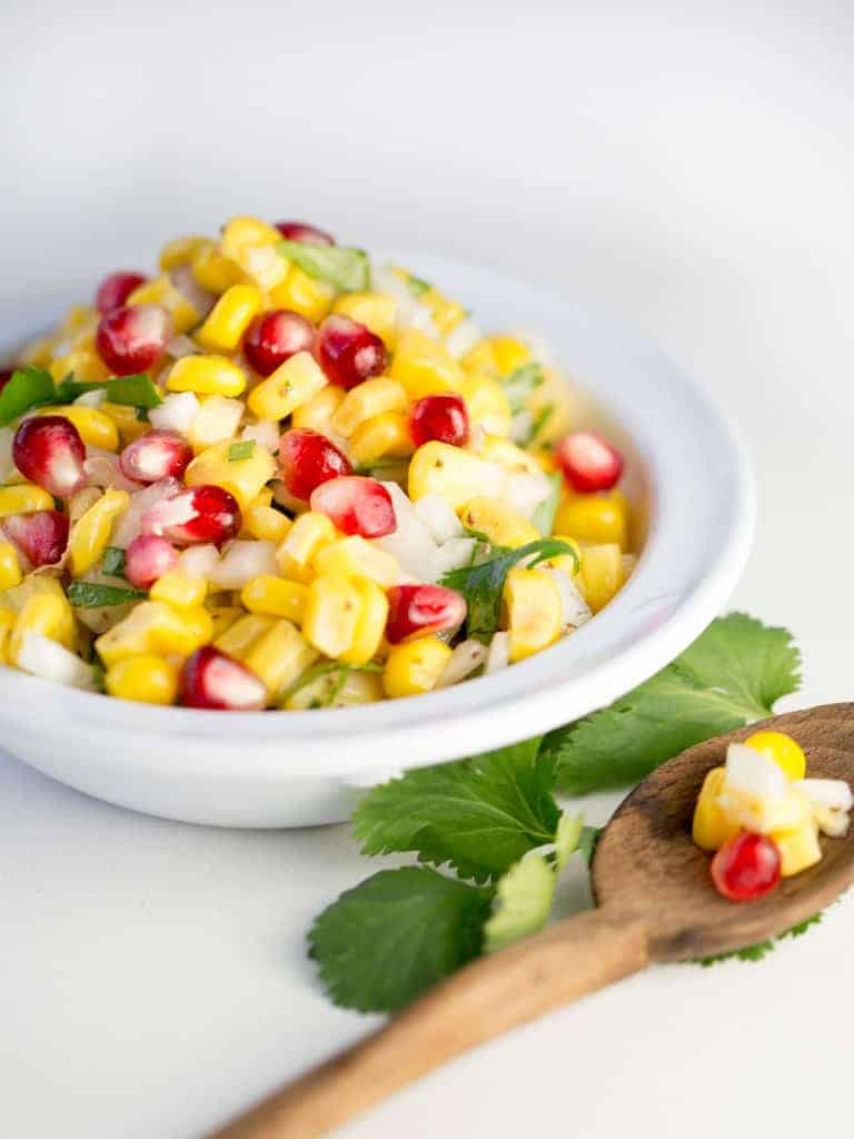 Corn Salad With Cilantro is a quick colorful salad full of fresh flavores perfect as a side salad, topping on meats or as a dip with chips.