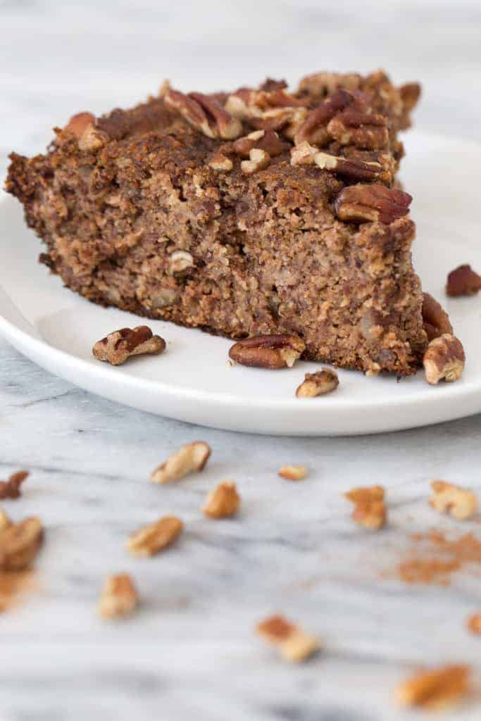 vegan banana bread on a plate with nuts