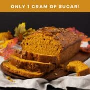 Pumpkin bread loaf on board with slices