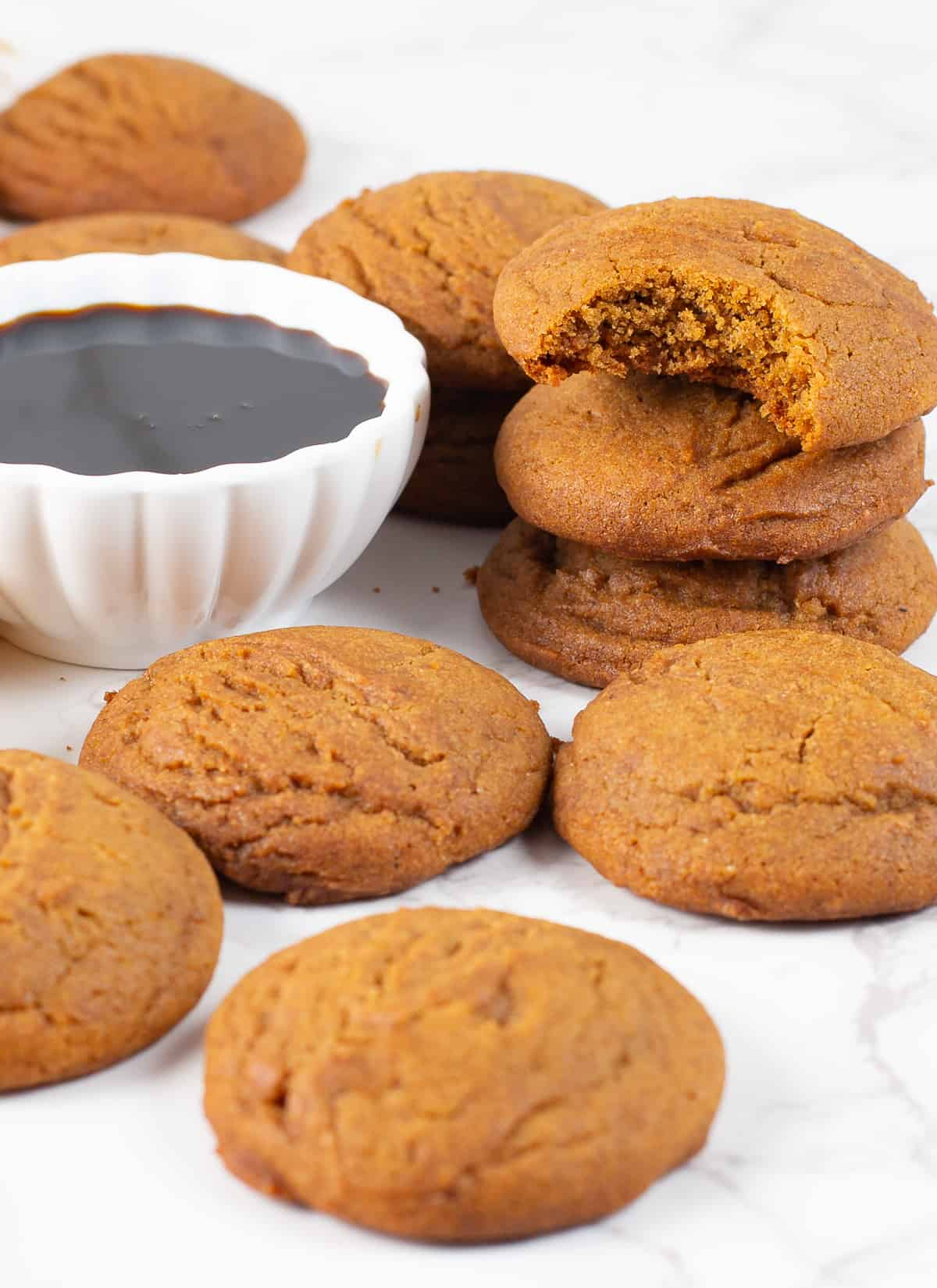 Soft and Chewy Blackstrap Molasses Cookies with bowl of molasses