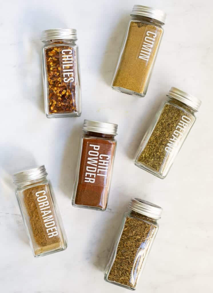 spices in jars for canned chili