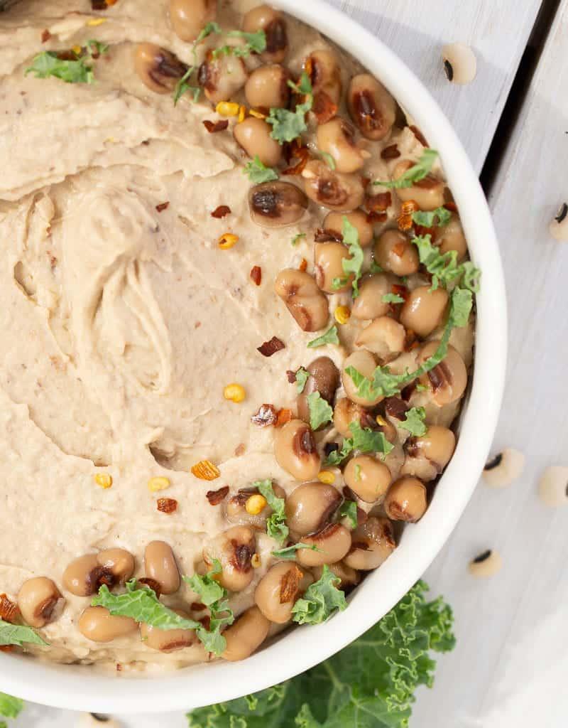 black eyed pea hummus with peas on top