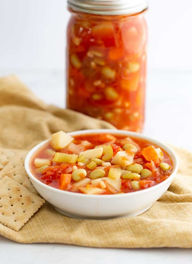 canned vegetable soup in a jar and a bowl