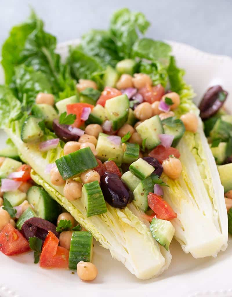 greek wedge salad on a plate with toppings