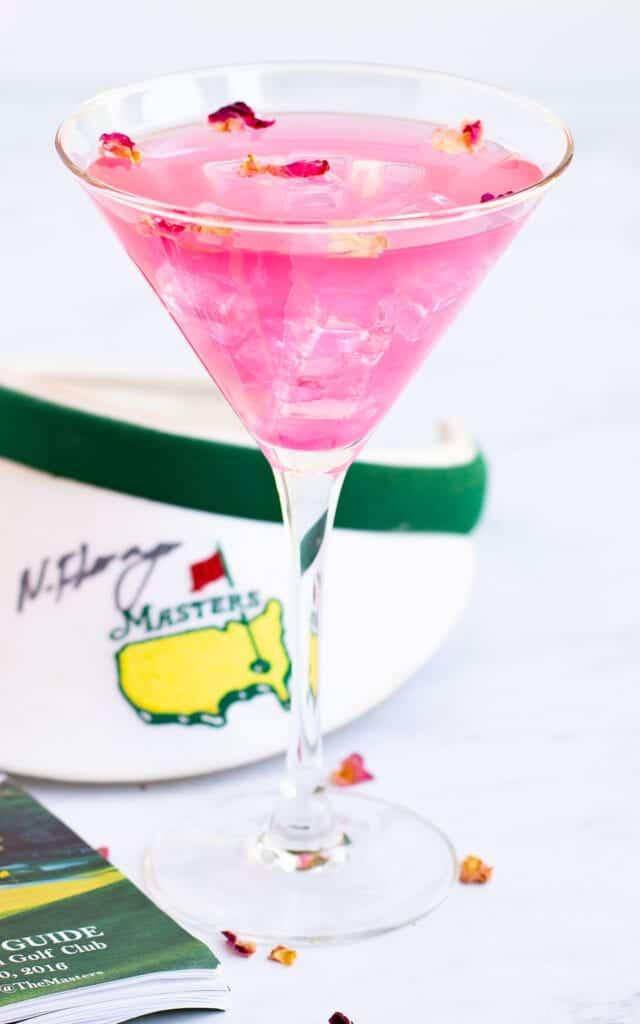 Augusta Azalea Cocktail in a glass with golf hat near
