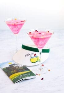 Augusta Azalea Cocktail in a glass with golf book near