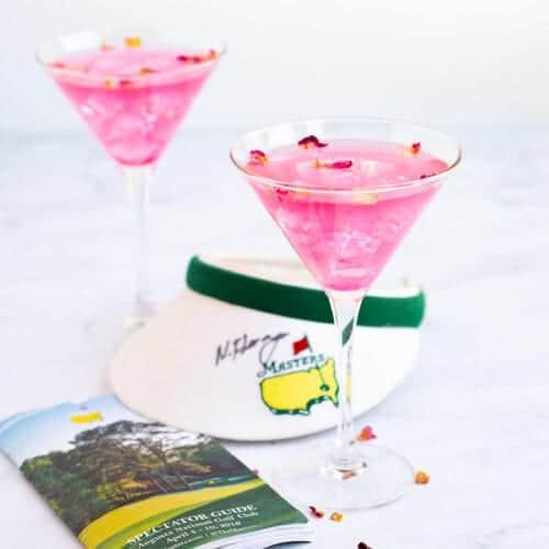 Augusta Azalea Cocktail in a glass with golf book near