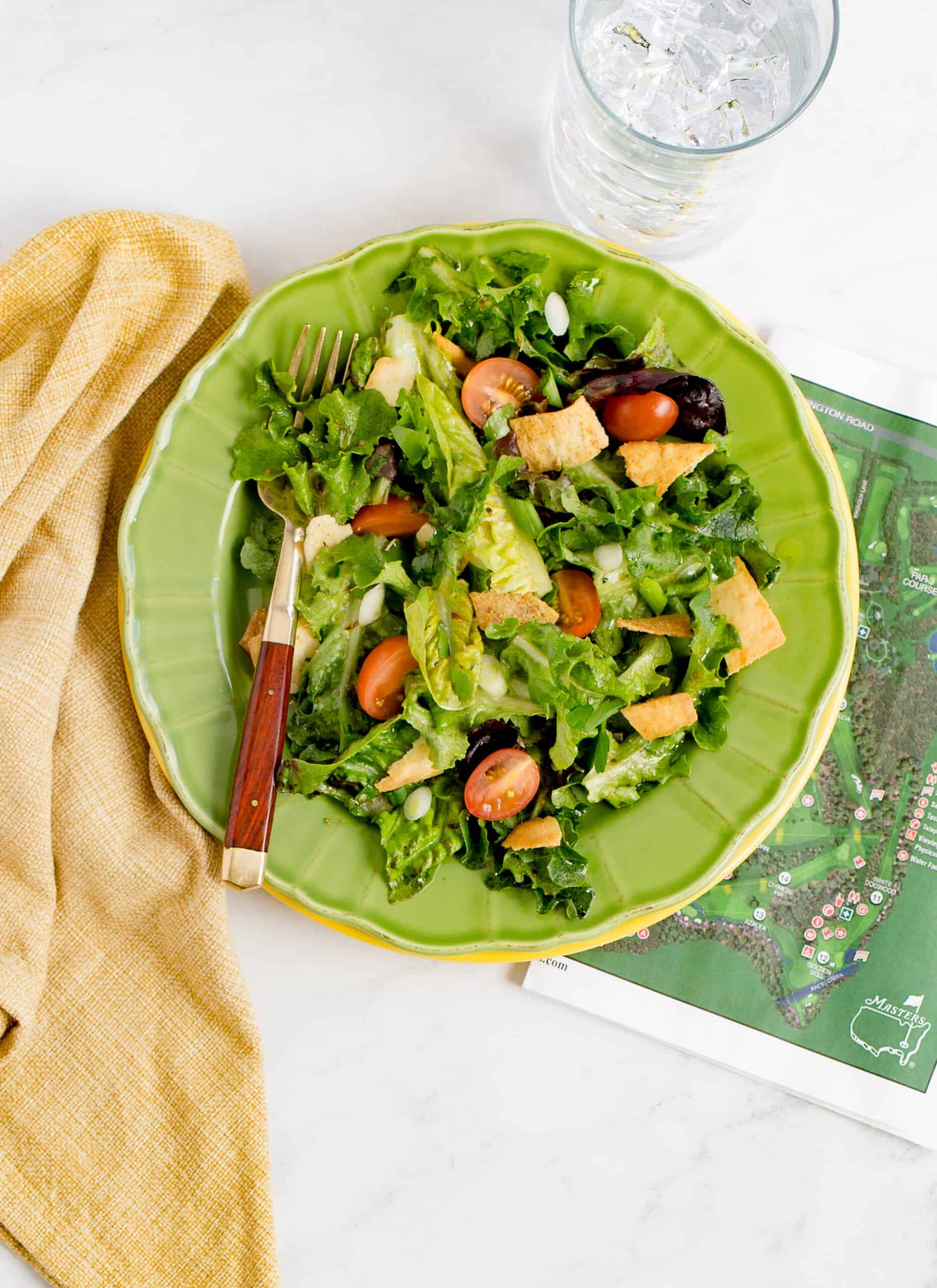 Famous green jacket salad on a plate with map of maters near