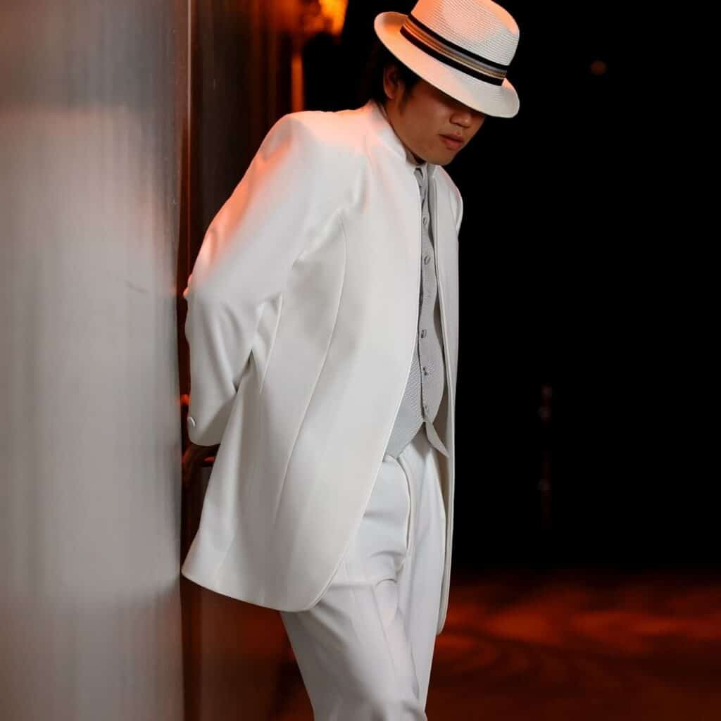 Best Dress Up Party Themes For Adults man in white suit