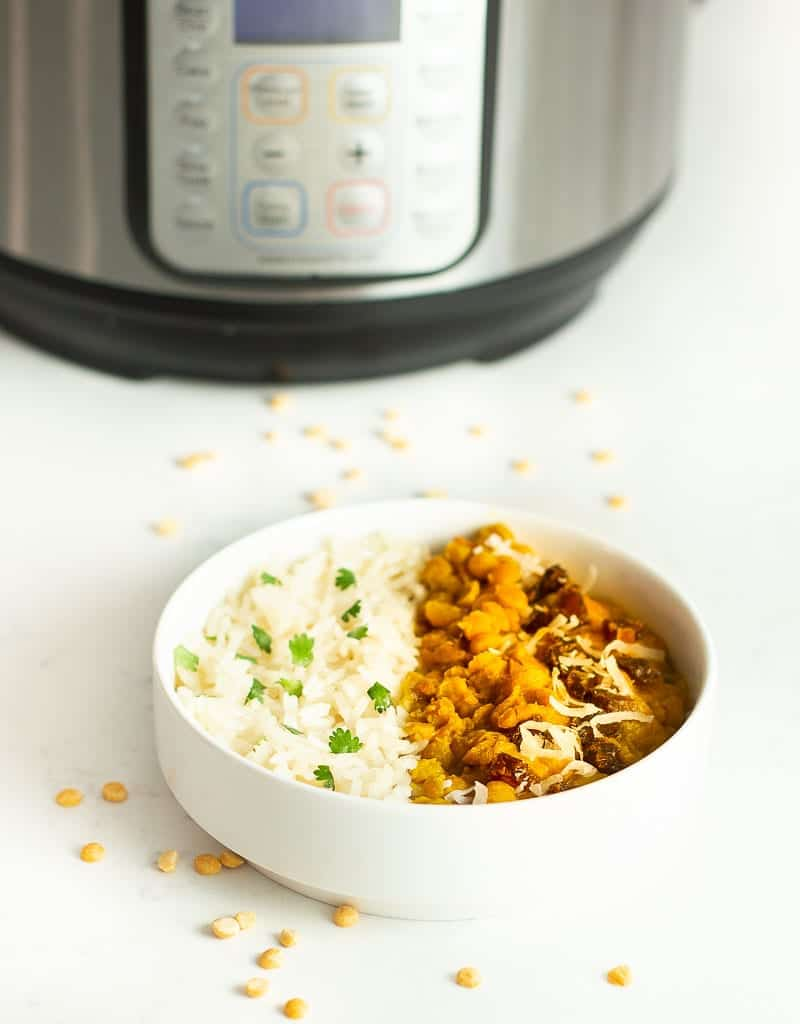 toor dal instant pot recipe in a bowl with rice and instant pot in background
