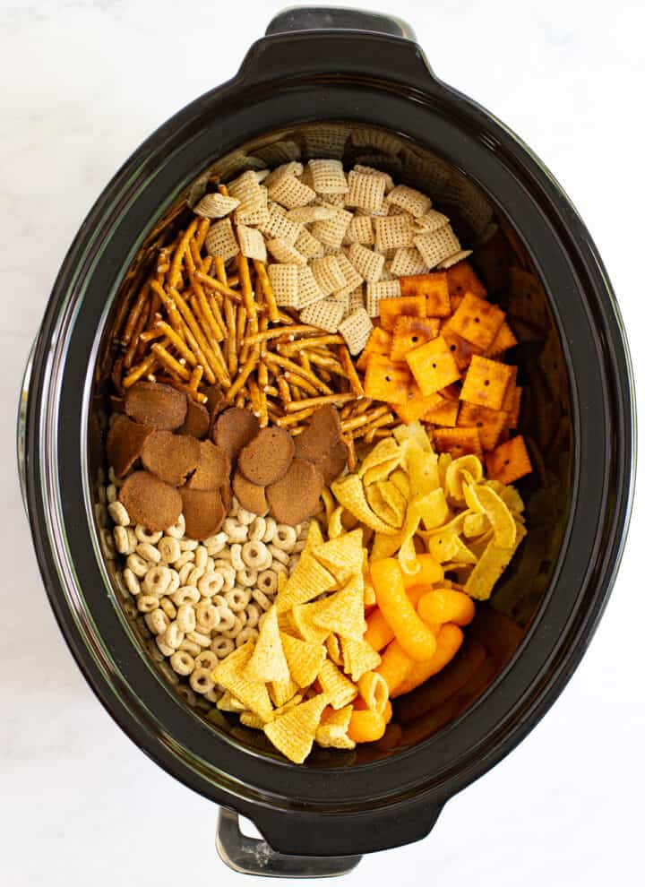 Easy & Unique Slow Cooker Chex Mix Recipe in a crock pot before seasoning added