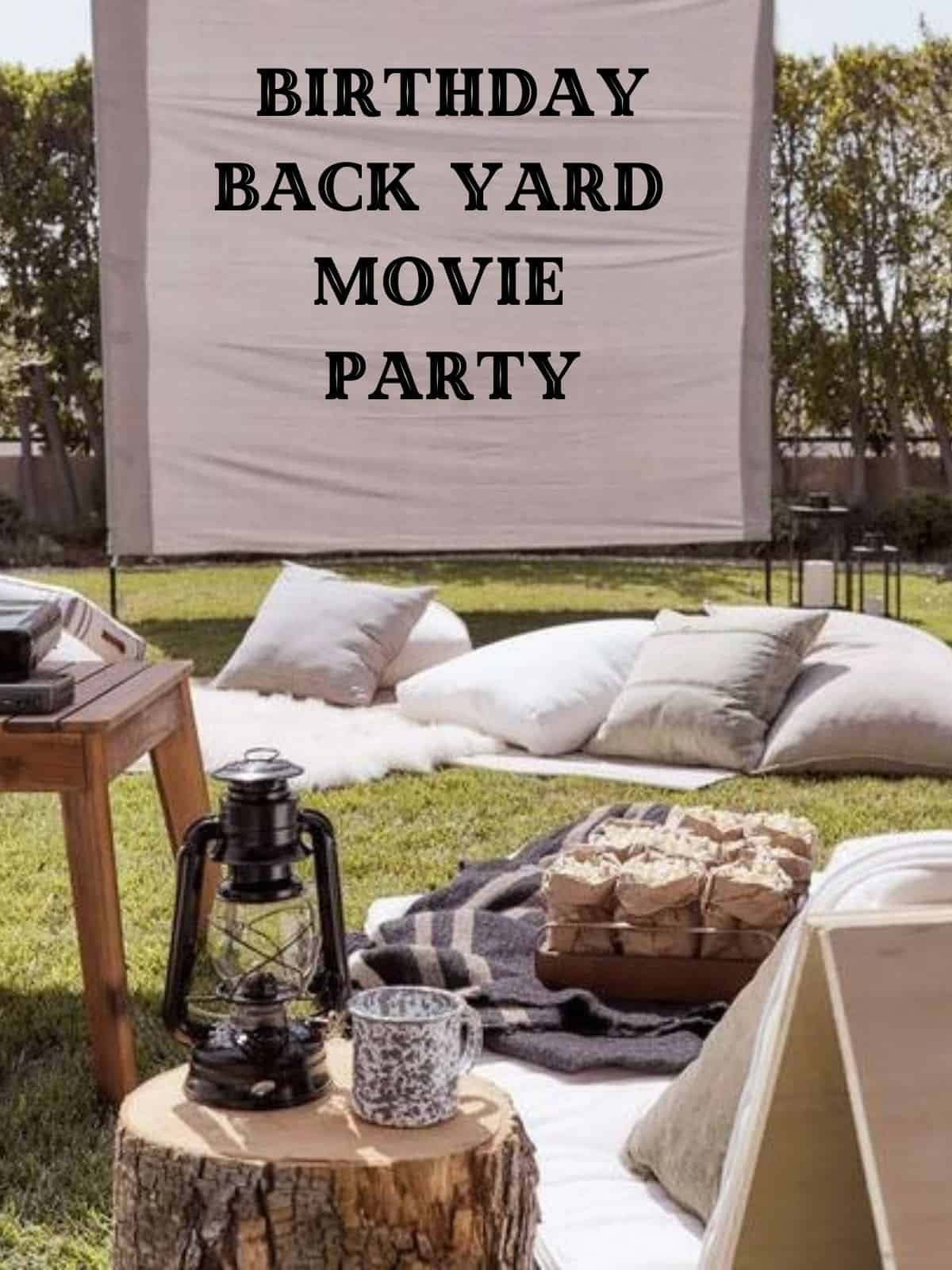 movie screen and pillows for adult birthday movie party in the yard