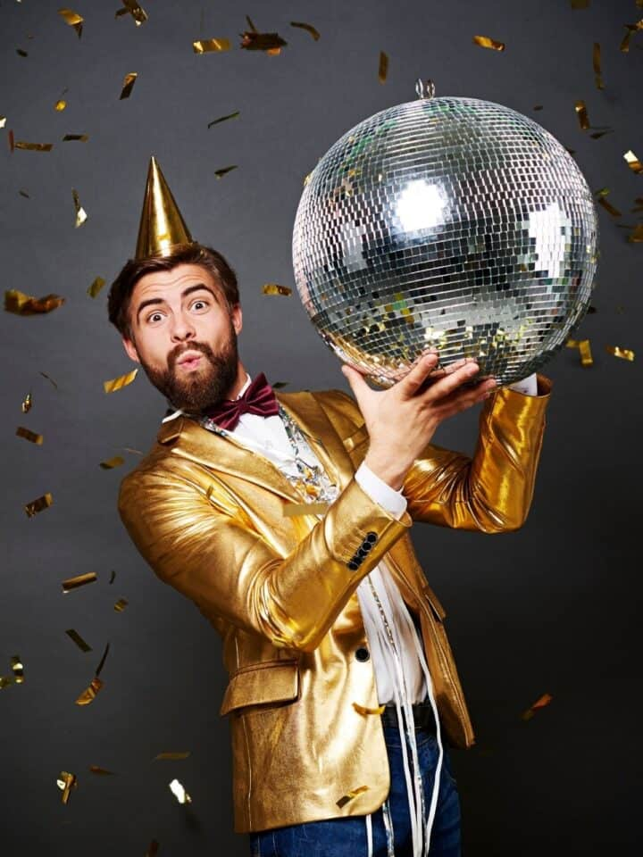 gold suit guy holding disco ball