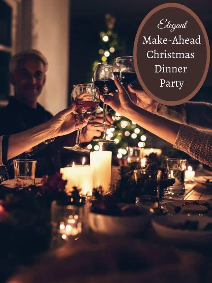 people toasting wine over christmas dinner table